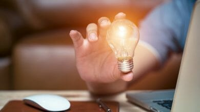 Business strategies for creative expression with a light bulb idea.